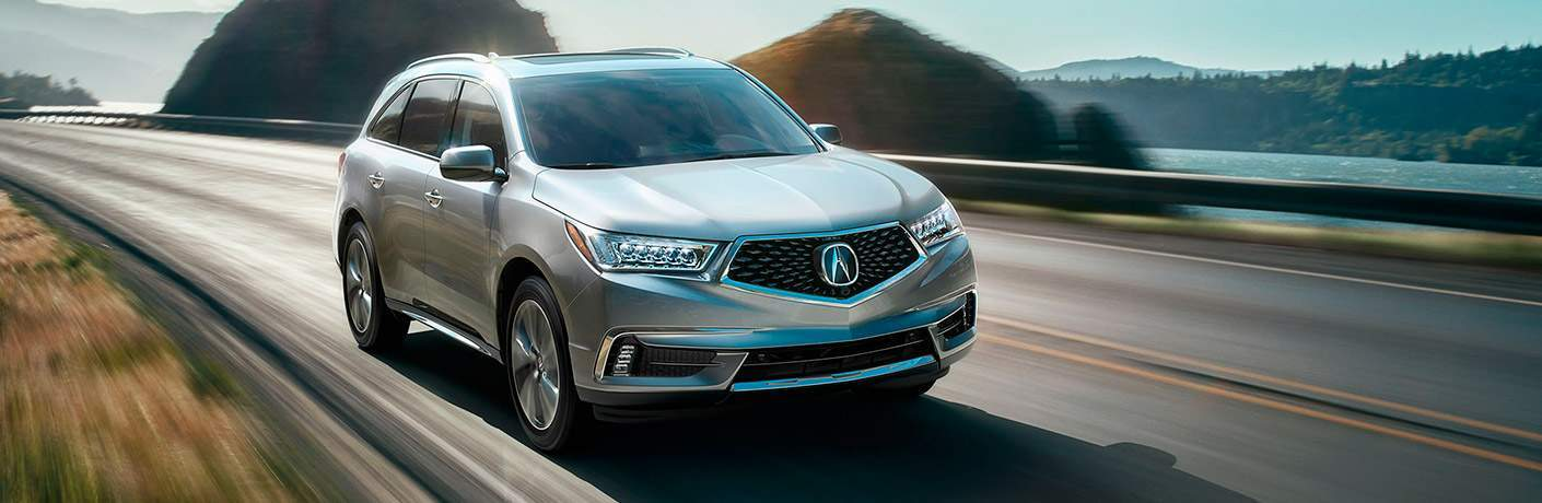 2017 Acura MDX cruising on an oceanside road