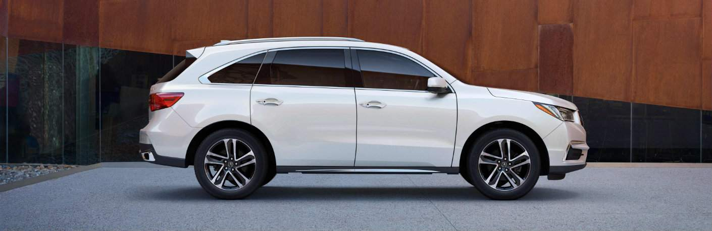 side profile of white 2018 Acura MDX parked in driveway