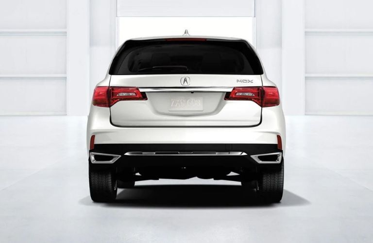 Exterior view of the rear of a white 2019 Acura MDX