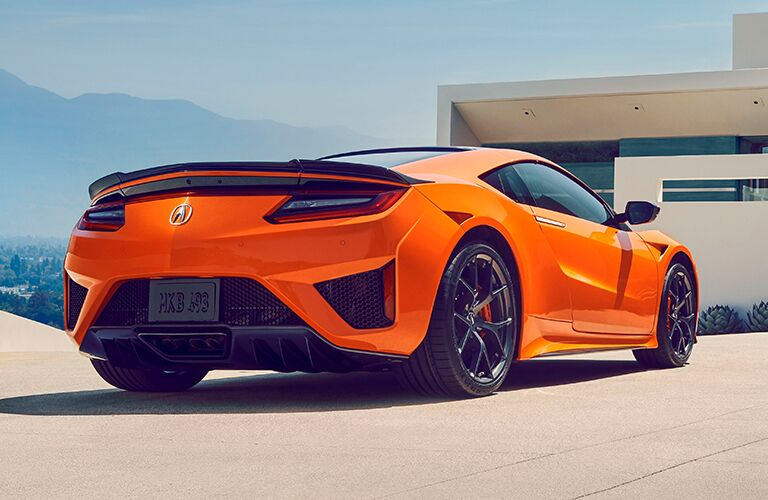 Exterior view of the rear of an orange 2019 Acura NSX