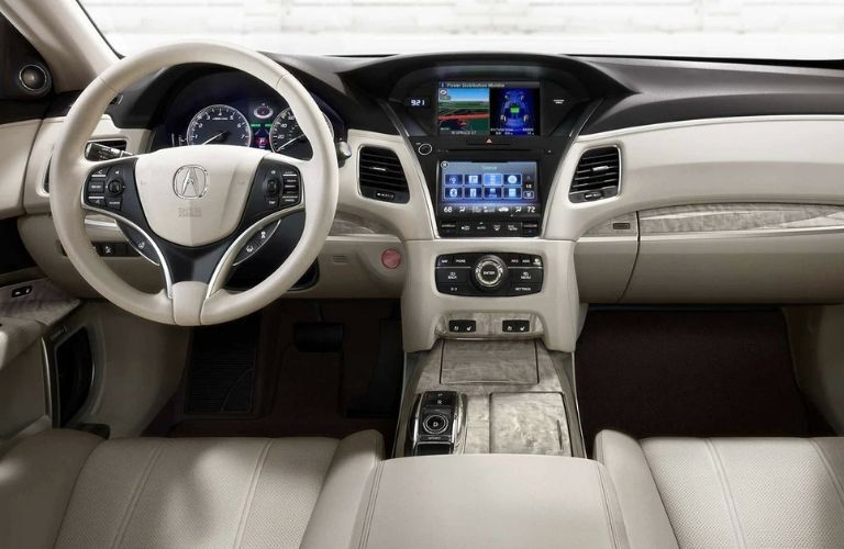 Interior view of the front seating area and dashboard inside a 2019 Acura RLX Sport Hybrid