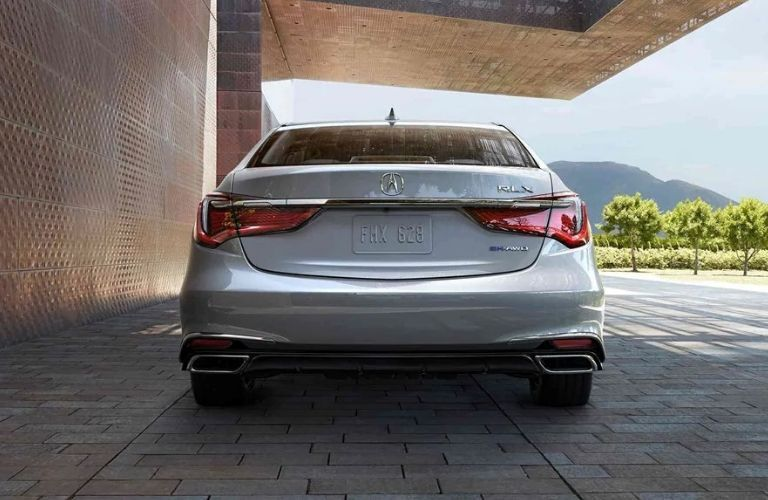 Exterior view of the rear of a silver 2019 Acura RLX Sport Hybrid