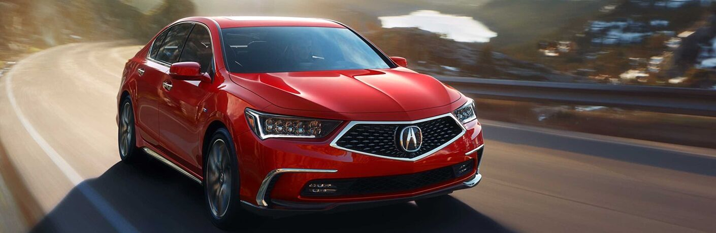 Red 2019 Acura RLX driving on mountainous road