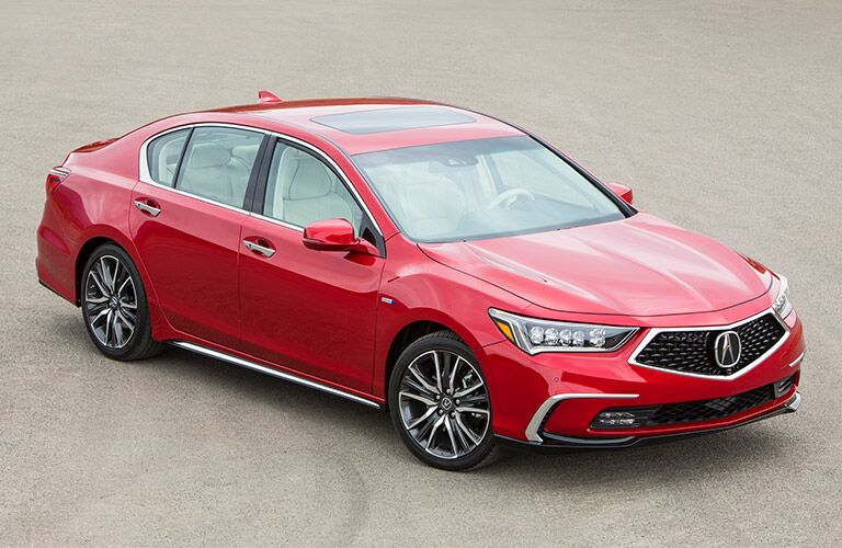 red 2019 Acura RLX on sand