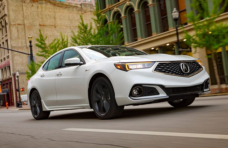 white 2019 Acura TLX in the city