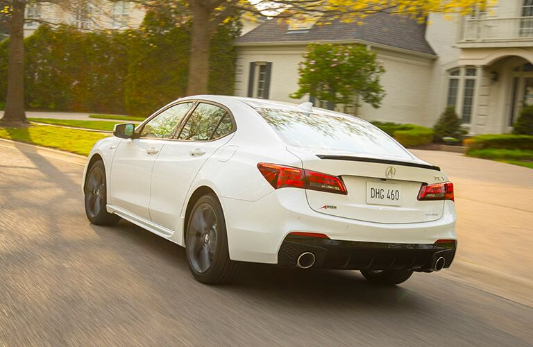 white 2019 Acura TLX rear view in front of house
