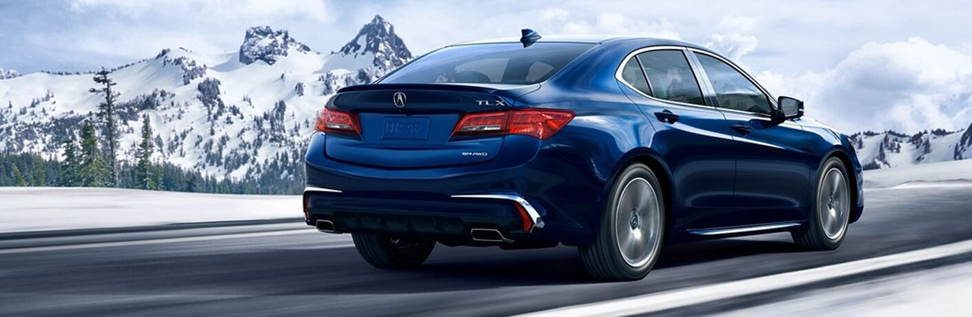 blue 2019 Acura TLX rear view by mountains