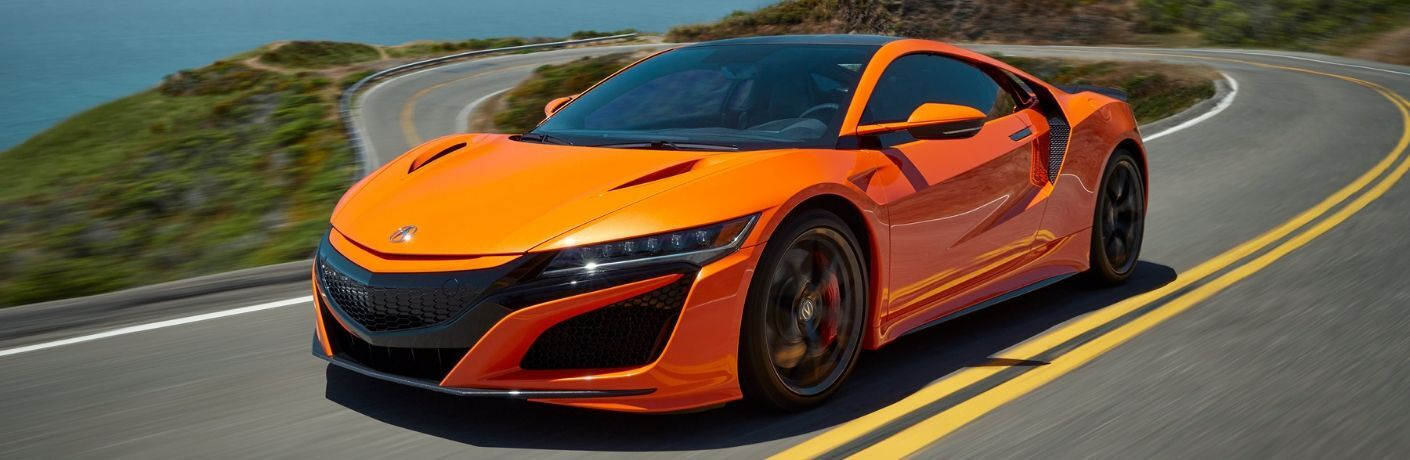 Exterior view of an orange 2020 Acura NSX