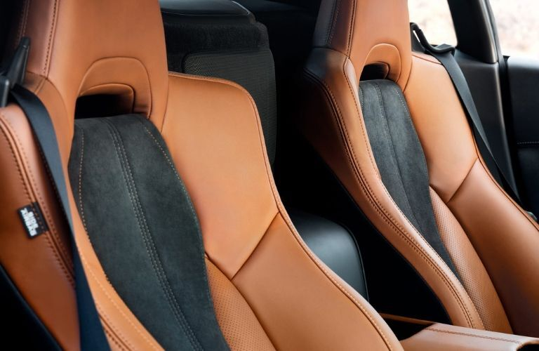 Interior view of the brown and black seating inside a 2020 Acura NSX