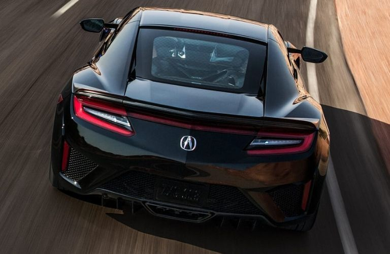 Exterior view of the rear of a black 2020 Acura NSX