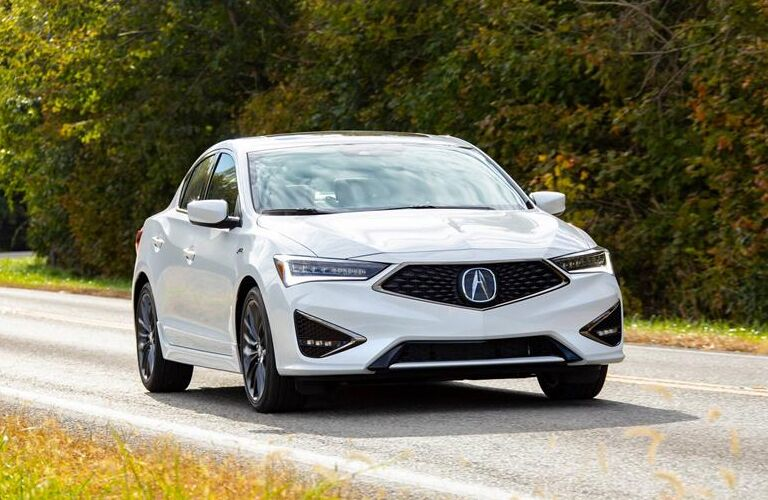 Passenger's side front angle view of white 2020 Acura ILX