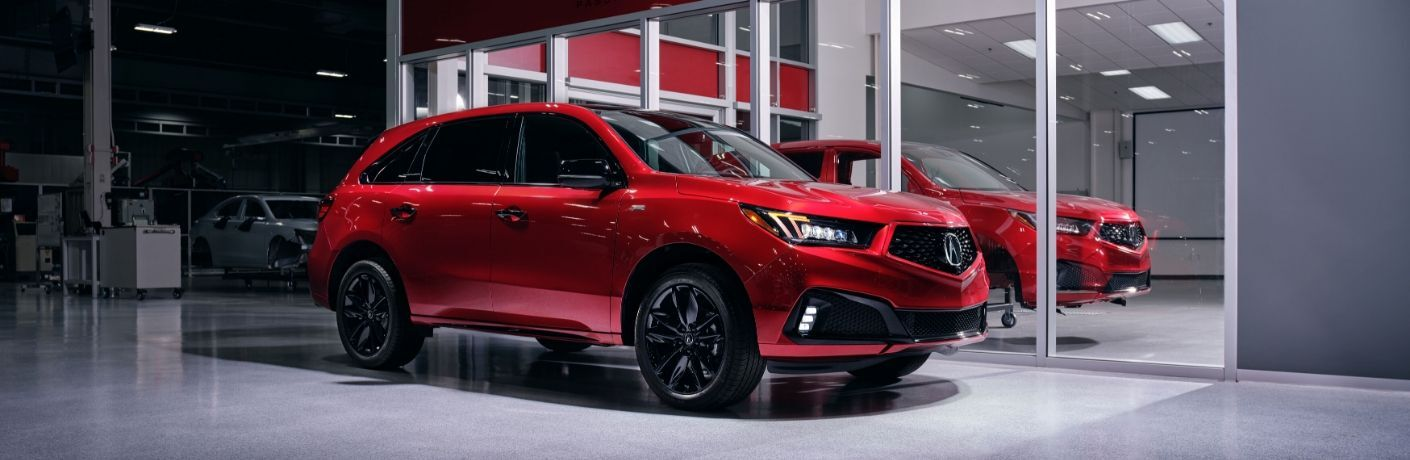 Exterior view of a red 2020 Acura MDX