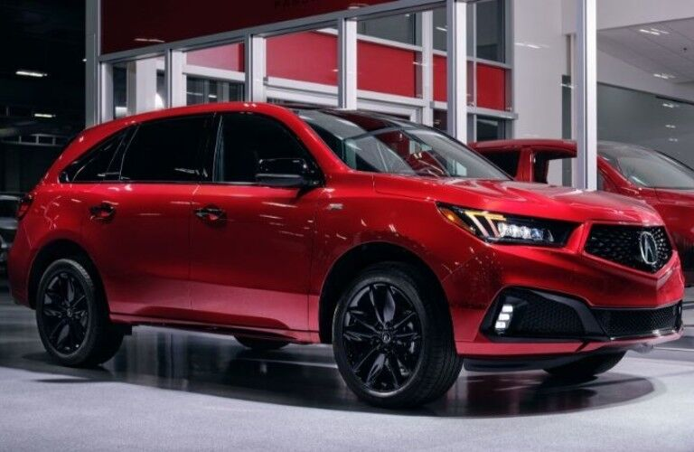 Exterior view of the front of a red 2020 Acura MDX