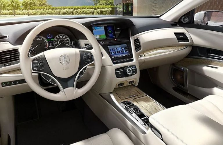 Interior view of the steering wheel and touchscreen inside a 2020 Acura RLX