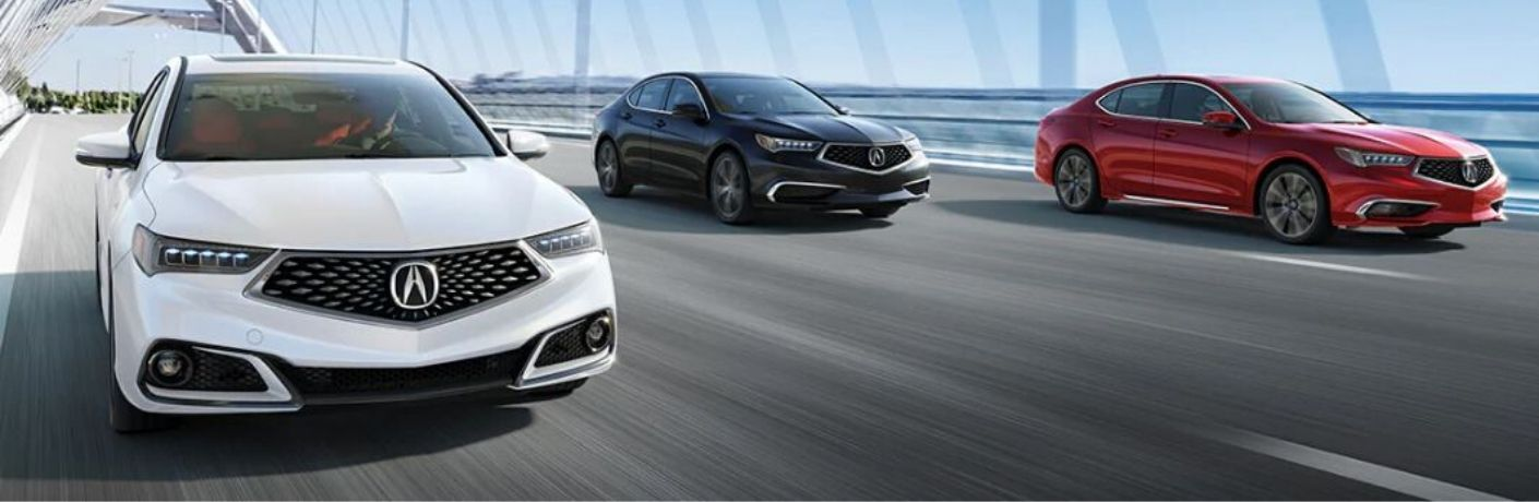 Exterior view of three 2020 Acura TLX models driving over a bridge