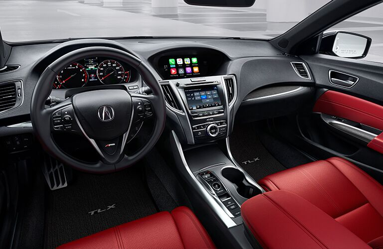 Dark grey dashboard and red front seats in 2020 Acura TLX