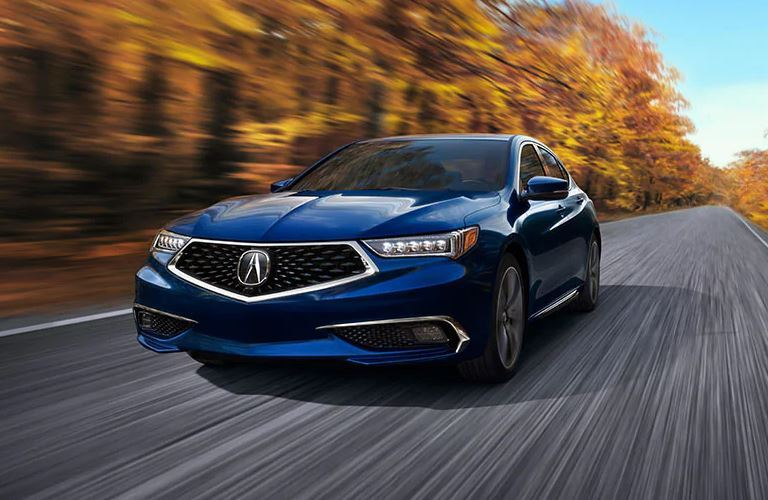 Exterior view of the front of a blue 2020 Acura TLX