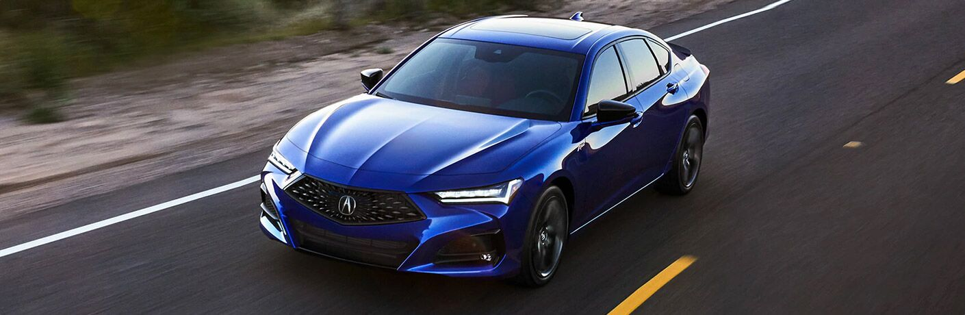 Driver's side front angle view of blue 2021 Acura TLX
