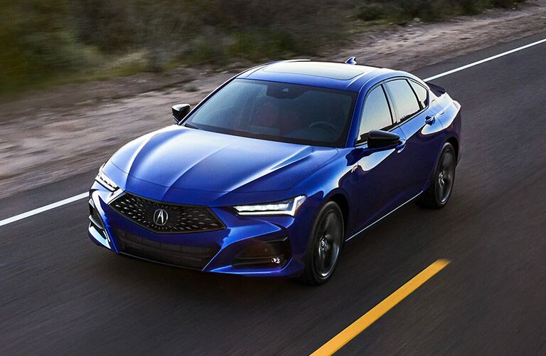 Blue 2021 Acura TLX on a Highway