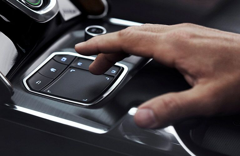 Hand Using 2021 Acura TLX Touchpad