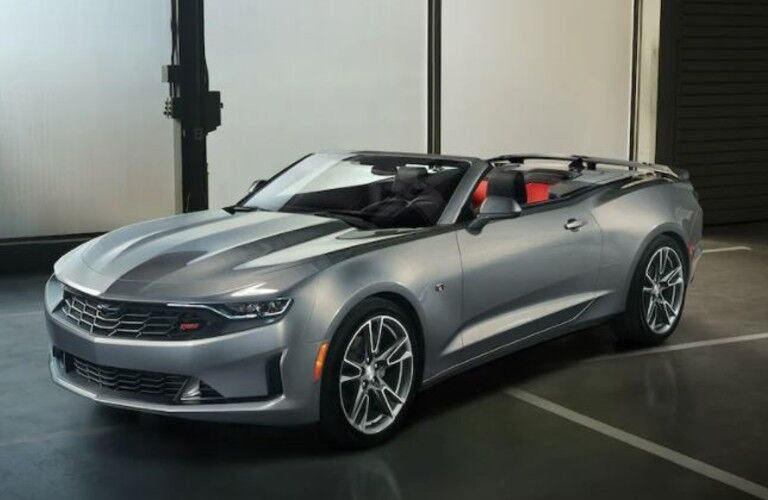A 2021 Chevy Camaro parked in a building