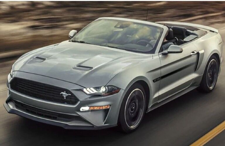 A 2021 Ford Mustang driving on a road