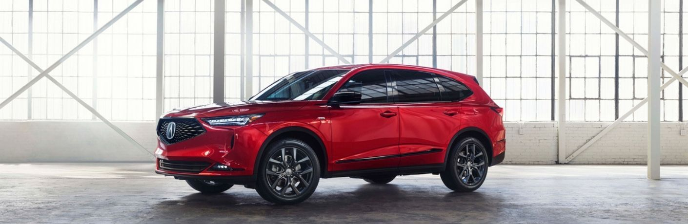 Red 2022 Acura MDX in a Warehouse