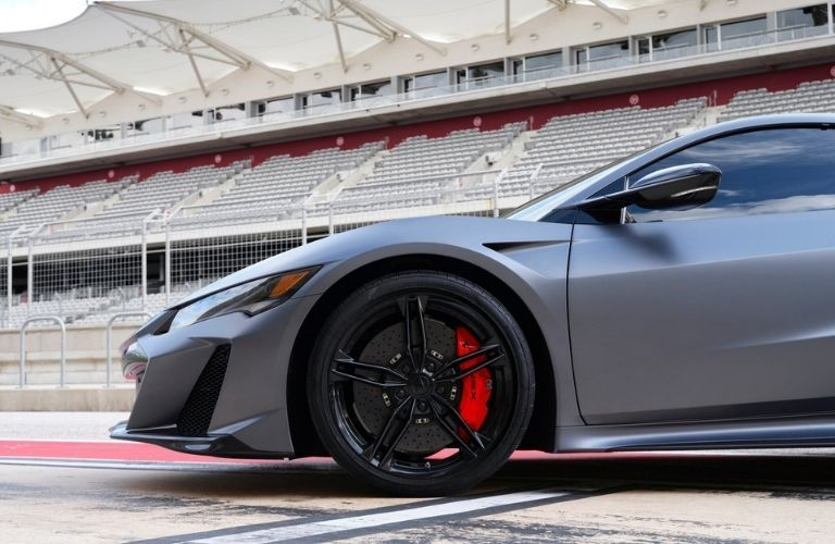 side view of 2022 Acura NSX Type S showcasing brake pads