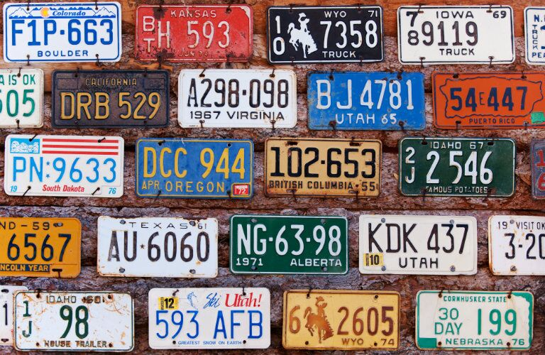 license plates from different states posted on wall