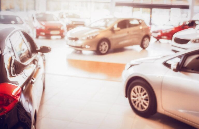 selection_of_small_cars_parked_in_dealership_showroom