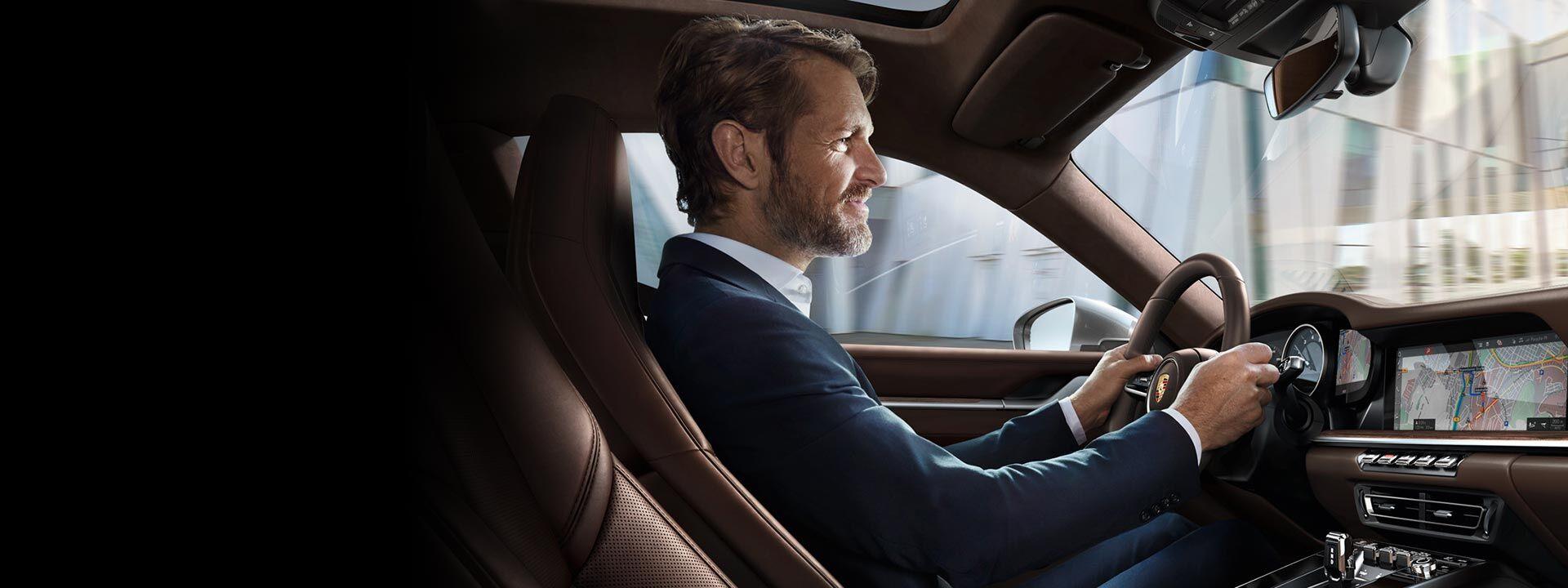 A man driving in a Porsche in Bakersfield, CA