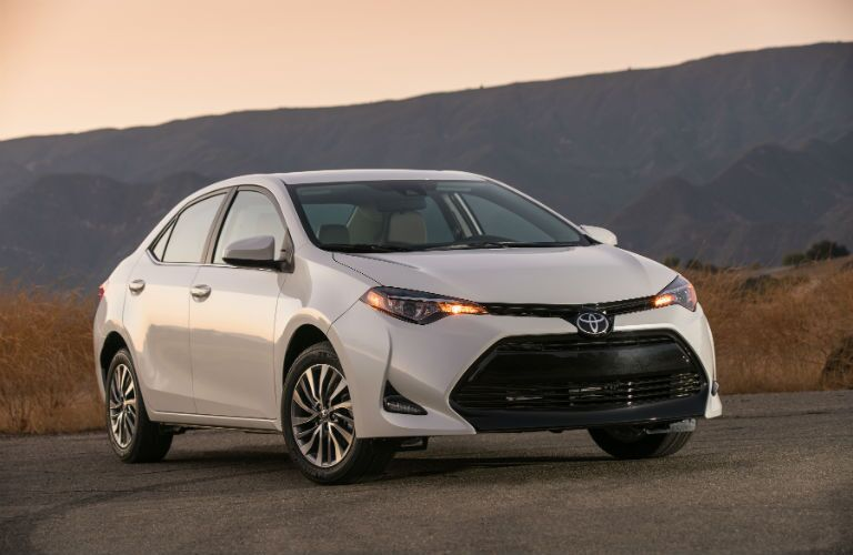 2018 Toyota Corolla Exterior Front Fascia and Passenger Side with Hill Background