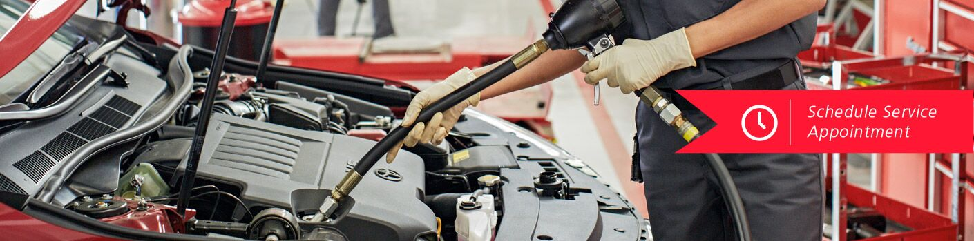 Mechanic Changing Fluids, Schedule Service Appointment
