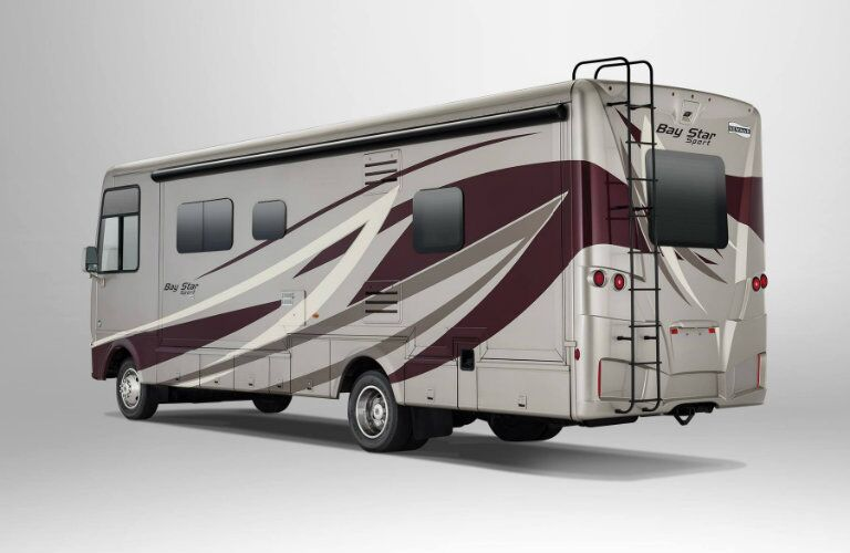 Exterior view of the rear of a tan and red 2019 Newmar Bay Star Sport
