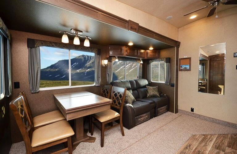 RV with table, chairs, and a sofa