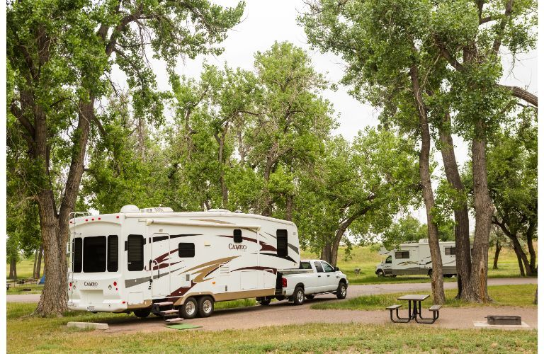 Fifth-wheel trailer at a campground