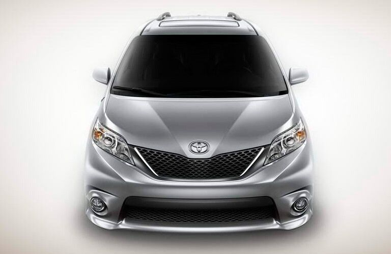 2014 Toyota Sienna over a white background