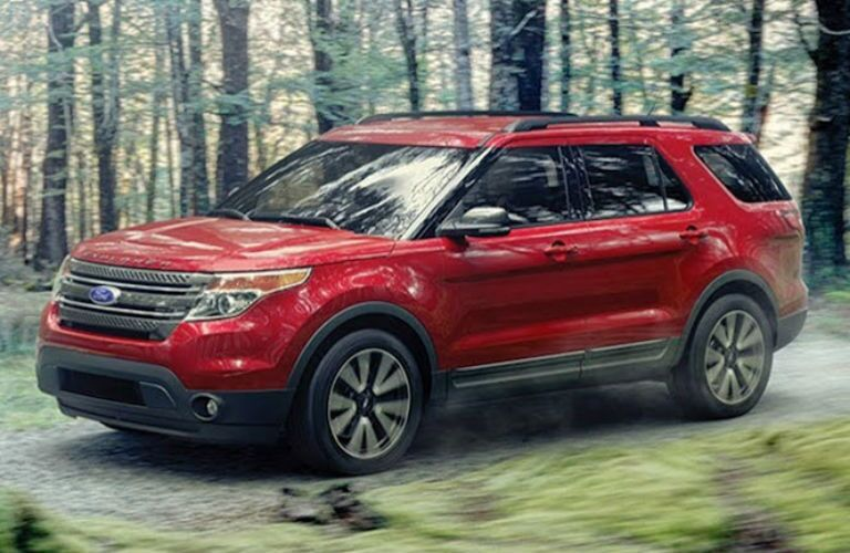Driver side exterior view of a red 2015 Ford Explorer
