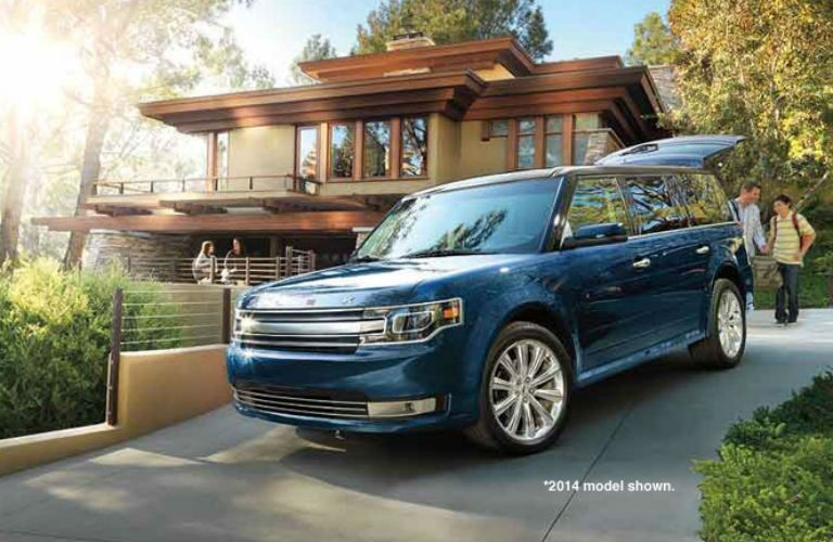 Driver side exterior view of a blue 2015 Ford Flex