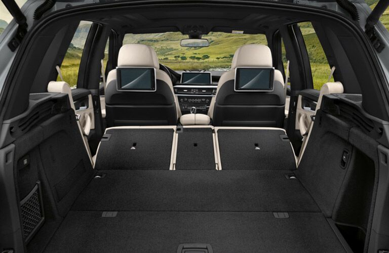 Rear seats folded flat for storage in the 2017 BMW X5