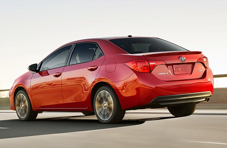 Driver side exterior view of a red 2017 Toyota Corolla