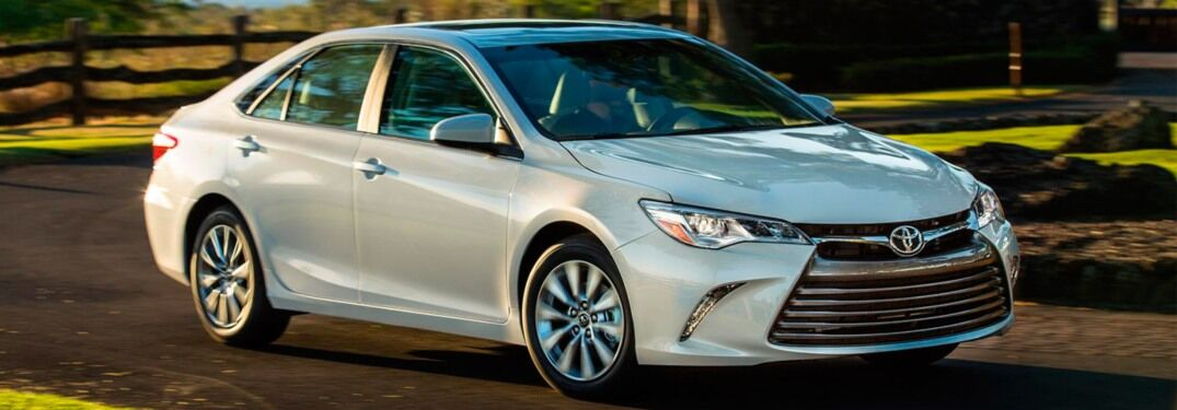 2017 Toyota Camry driving down a rural road