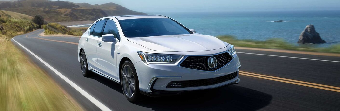 2018 Acura RLX driving on a road by the ocean