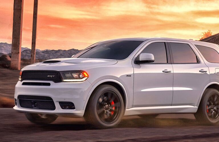 2019 Dodge Durango driving down a rural road at sunset