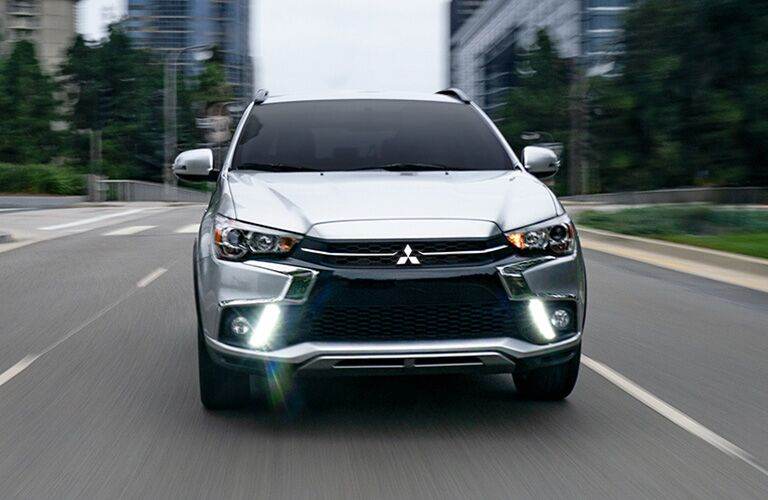 2019 Mitsubishi Outlander Sport driving down a city street