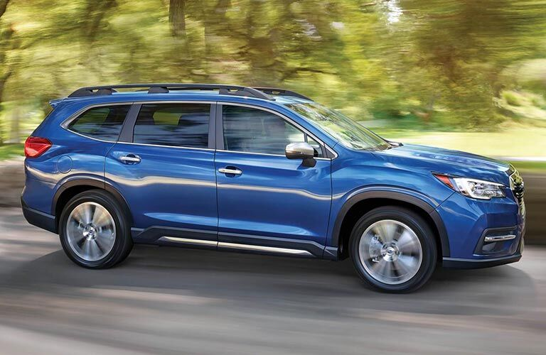 2019 Subaru Ascent driving fast down a forest road