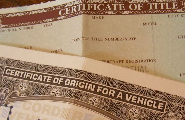 A stock photo of vehicle title documents.
