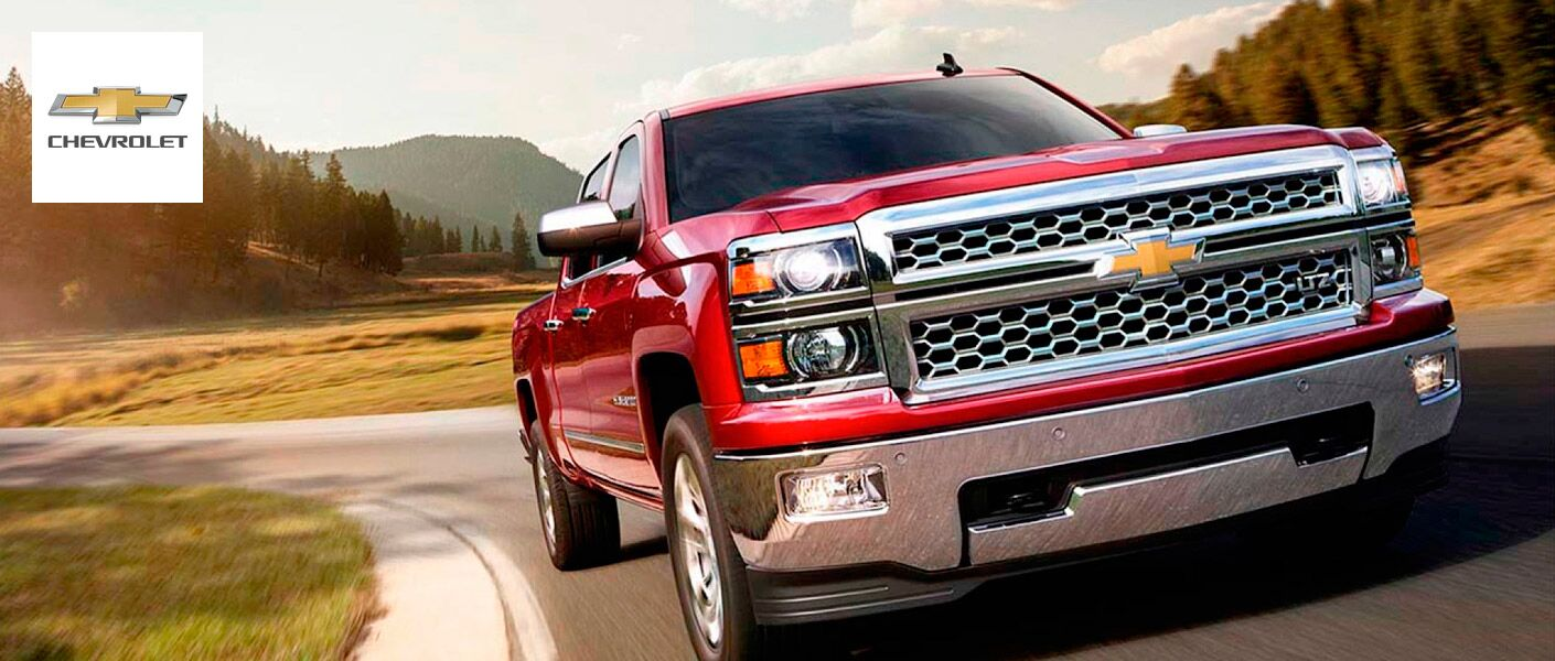 Front View of 2018 Chevy Silverado 1500 in Red Exterior with Chevy Logo to the Left