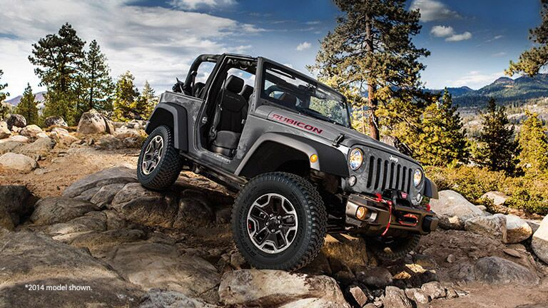 Grey 2014 Jeep Wrangler Rubicon on Rocks