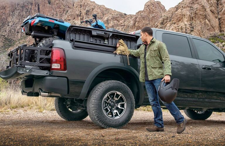 2018 Ram 1500 Side View of Man near Gray Truck's Liftgate